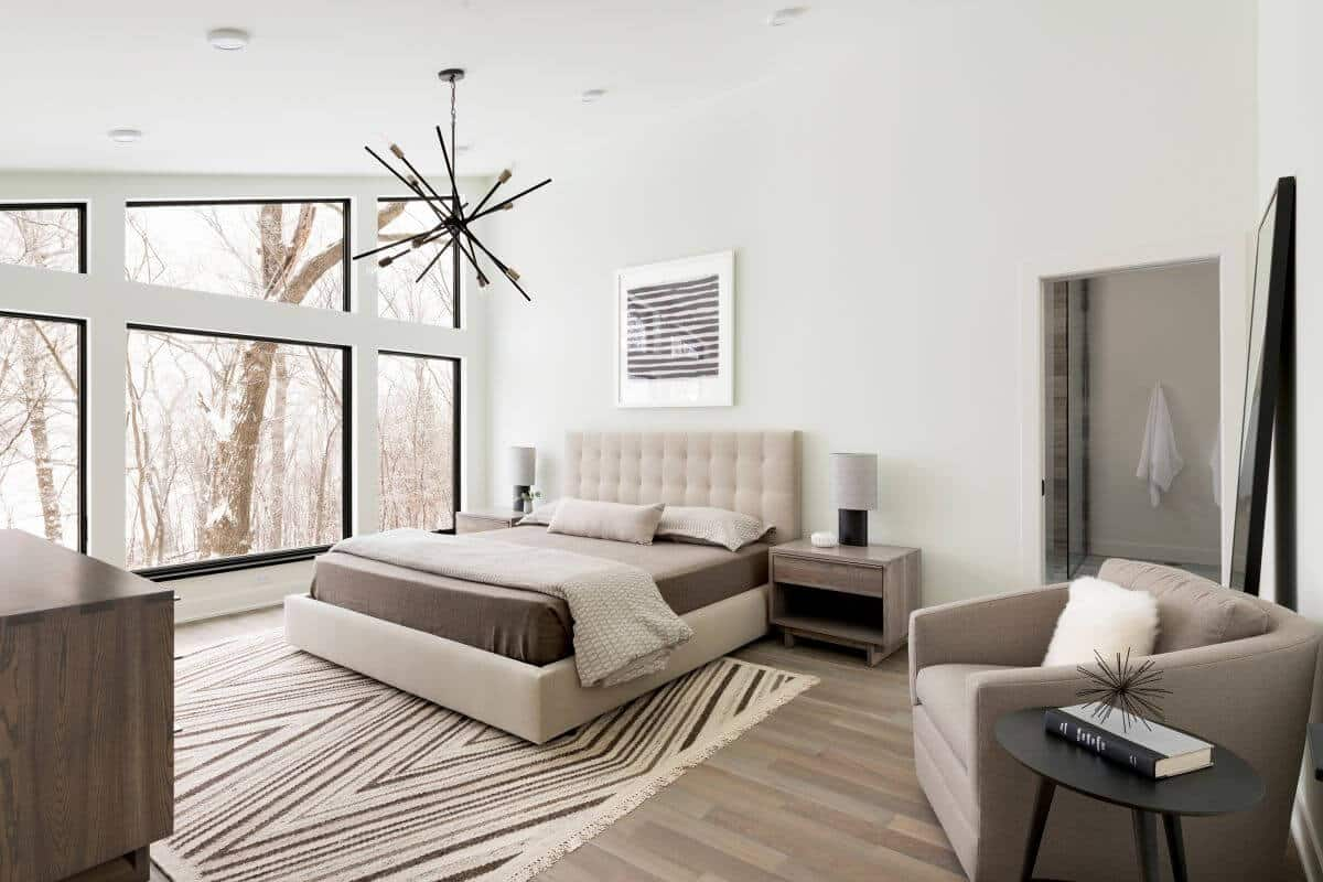 master bedroom in modern lodge style home built in Minnesota